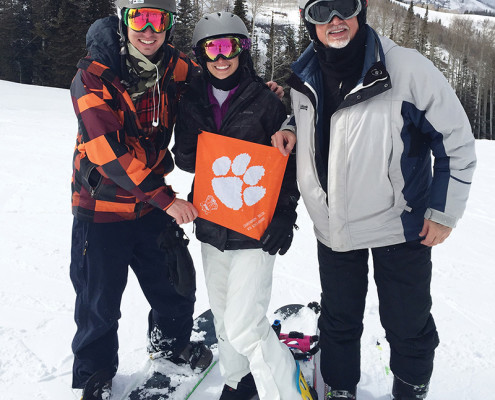 Utah Brett, Sydney '17 and Frank '81 Watts show their Clemson spirit at Park City.