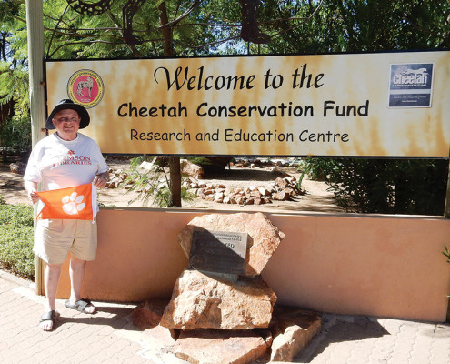 Namibia Mike Kohl, retired head of the University Libraries Special Collections, shows his Tiger Rag while volunteering at the Cheetah Conservation Fund near Otjiwarongo.